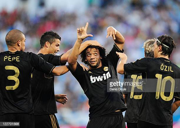 Marcelo of Real Madrid celebrates after scoring Real's 2nd goal during the La Liga match between Real Zaragoza and Real Madrid at estadio La Romareda...
