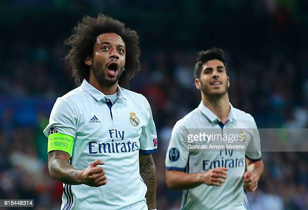 Marcelo of Real Madrid celebrates scoring his team's second goal during the UEFA Champions League Group F match between Real Madrid CF and Legia...