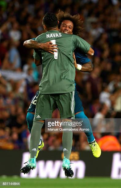 Marcelo of Real Madrid celebrates with his teammate Keylor Navas during the Supercopa de Espana Supercopa Final 1st Leg match between FC Barcelona...