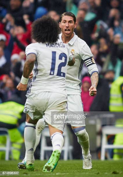 Marcelo of Real Madrid celebrates with Sergio Ramos of Real Madrid after scoring the second goal during the La Liga match between Real Madrid CF and...