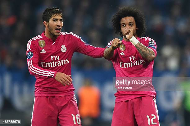 Marcelo of Real Madrid celebrates with teammate Lucas Silva of Real Madrid after scoring his team's second goal during the UEFA Champions League...