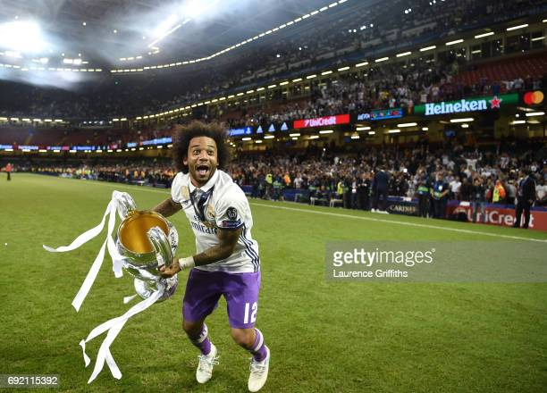 Marcelo of Real Madrid celebrates with the Champions League Tropy after the UEFA Champions League Final between Juventus and Real Madrid at National...