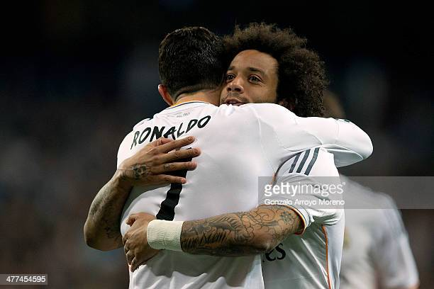 Marcelo of Real Madrid CF celebrates scoring their second goal with teammate Cristiano Ronaldo during the La Liga match between Real Madrid CF and...