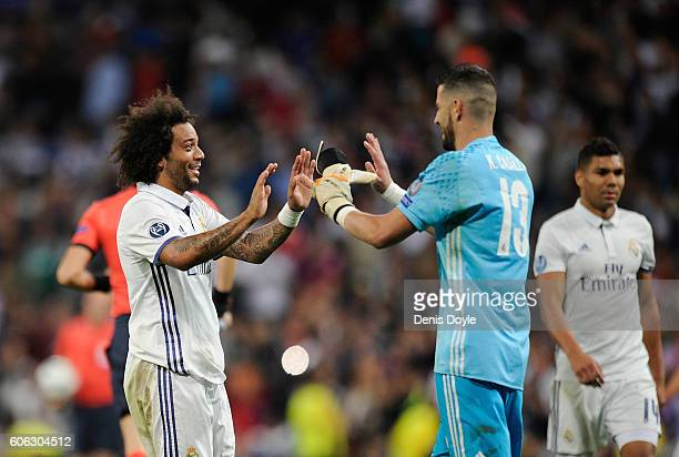 Marcelo of Real Madrid Cf celebrates with Kiko Casilla after beating Sporting Clube de Portugal 21 in the UEFA Champions League Group F match between...