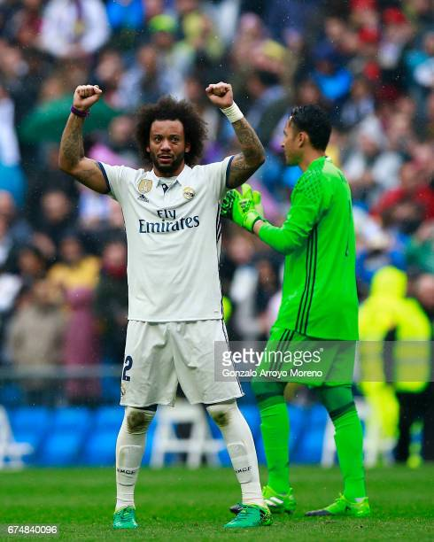 Marcelo of Real Madrid CF celebrates with teammate goalkeeper Keylor Navas after the La Liga match between Real Madrid CF and Valencia CF at Estadio...