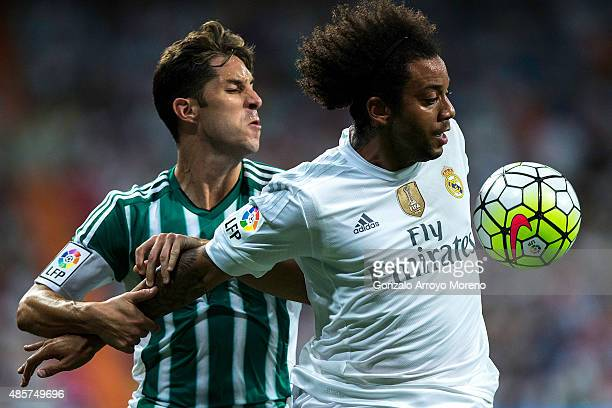 Marcelo of Real Madrid CF competes for the ball with Alvaro Cejudo of Real Betis Balompie during the La Liga match between Real Madrid CF and Real...
