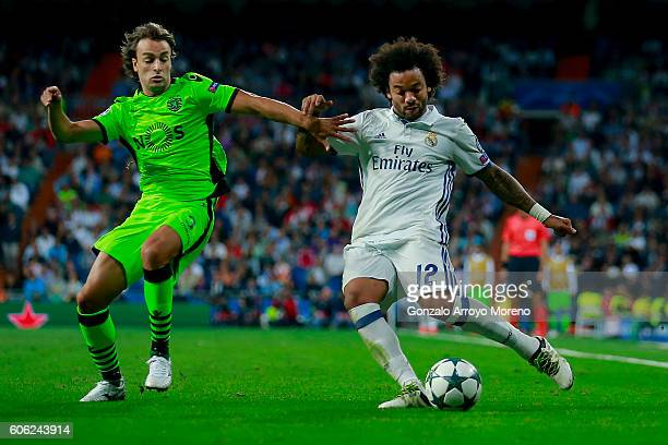 Marcelo of Real Madrid CF competes for the ball with Lazar Markovic of Sporting CP during the UEFA Champions League group stage match between Real...