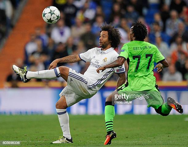 Marcelo of Real Madrid CF controls the ball beside Gelson Martins of Sporting Clube de Portugal during the UEFA Champions League match between XXX...