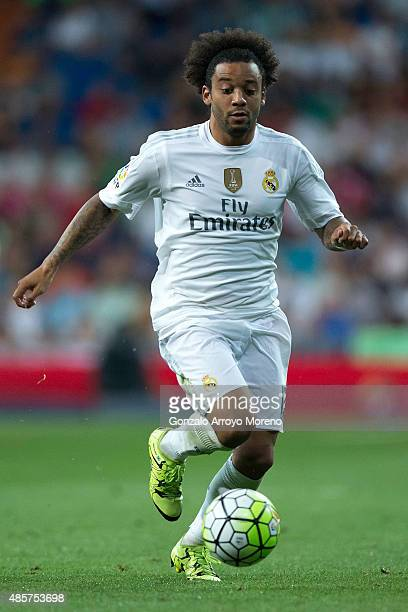 Marcelo of Real Madrid CF controls the ball during the La Liga match between Real Madrid CF and Real Betis Balompie at Estadio Santiago Bernabeu on...