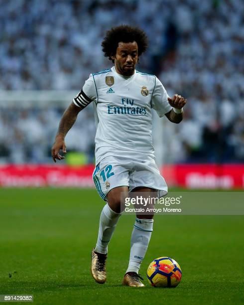Marcelo of Real Madrid CF controls the ball during the La Liga match between Real Madrid CF and Sevilla FC at Estadio Santiago Bernabeu on December 9...