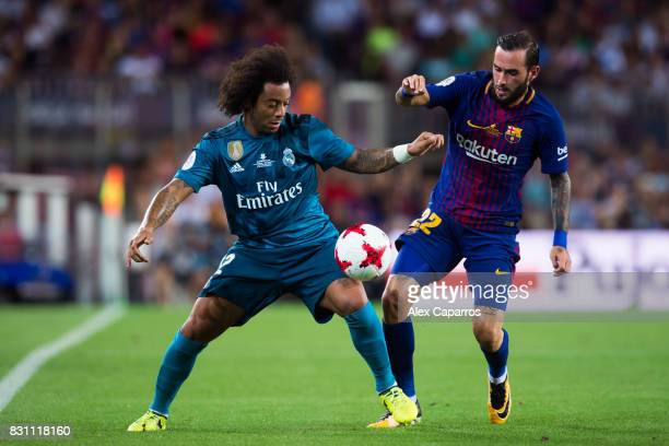 Marcelo of Real Madrid CF fights for the ball with Aleix Vidal of FC Barcelona during the Supercopa de Espana Supercopa Final 1st Leg match between...