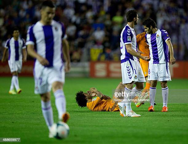 Marcelo of Real Madrid CF grimaces after being tackled by Benfica Mitrovic of Real Valladolid CF during the La Liga match between Real Valladolid CF...