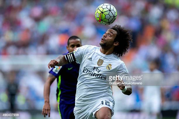 Marcelo of Real Madrid CF heads the ball during the La Liga match between Real Madrid CF and Malaga CF at Estadio Santiago Bernabeu on September 26...