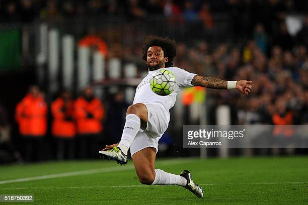 Marcelo of Real Madrid CF stretches to control the ball during the La Liga match between FC Barcelona and Real Madrid CF at Camp Nou on April 2 2016...