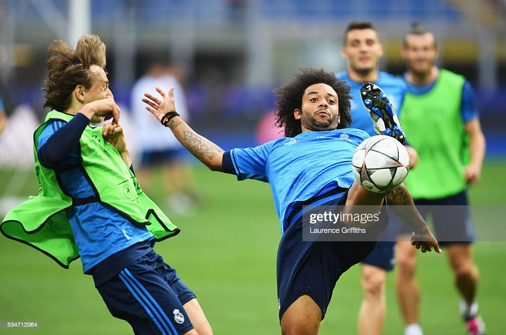 <a gi-track='captionPersonalityLinkClicked' href=/galleries/search?phrase=Marcelo+-+Attacking+Left+Back+-+Born+1988&family=editorial&specificpeople=2136789 ng-click='$event.stopPropagation()'>Marcelo</a> of Real Madrid controls the ball during a Real Madrid training session on the eve of the UEFA Champions League Final against Atletico de Madrid at Stadio Giuseppe Meazza on May 27, 2016 in Milan, Italy.