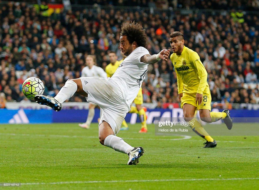 Marcelo of Real Madrid controls the ball during the La Liga match between Real Madrid CF and Villarreal CF at Estadio Santiago Bernabeu on April 20, 2016 in Madrid, Spain.