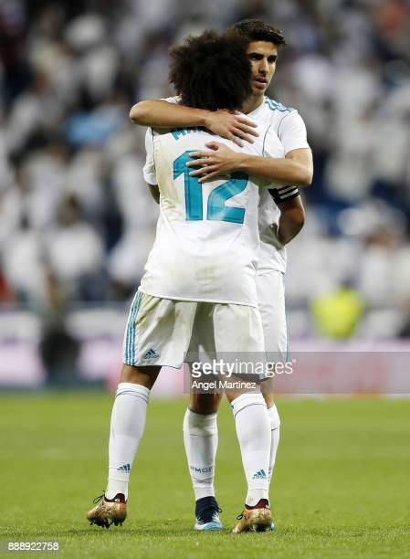 Marcelo of Real Madrid embraces Marco Asensio after the La Liga match between Real Madrid and Sevilla at Estadio Santiago Bernabeu on December 9 2017...