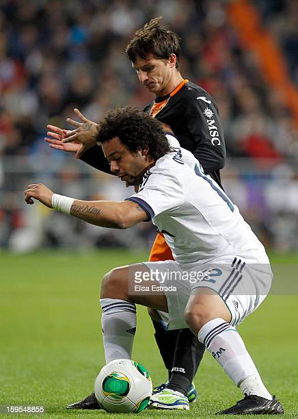 Marcelo of Real Madrid fights for the ball with Pablo Piatti of Valencia during the Copa del Rey Quarter Final match between Real Madrid and Valencia...