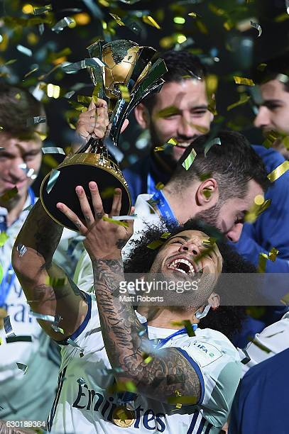 Marcelo of Real Madrid hold the trophy aloft during the FIFA Club World Cup final match between Real Madrid and Kashima Antlers at International...