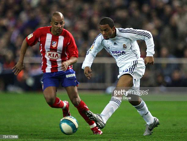 Marcelo of Real Madrid passes the ball beside Peter Luccin of Atletico Madrid during the Primera Liga match between Atletico Madrid and Real Madrid...