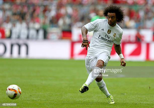 Marcelo of Real Madrid runs with the ball during the Audi Cup 2015 match between Real Madrid and Tottenham Hotspur at Allianz Arena on August 4 2015...