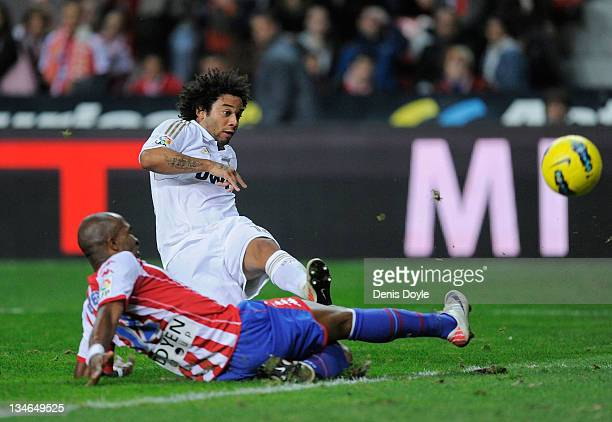 Marcelo of Real Madrid scories his team's third goal during the La Liga match between Sporting Gijon and Real Madrid at El Molinon Stadium on...