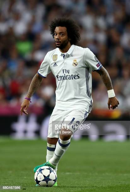 Marcelo of Real runs with the ball during the UEFA Champions League Semi Final first leg match between Real Madrid CF and Club Atletico de Madrid at...