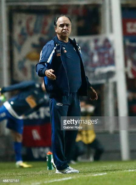 Marcelo Oliveira coach of Cruzeiro looks dejected after his team loose the quarter final match between San Lorenzo and Cruzeiro as part of Copa...