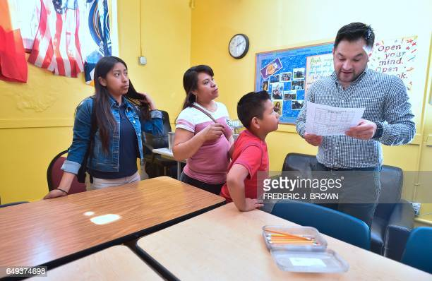 Marcelo Olmos Development Director at Academia Avance charter school in Los Angeles California looks over forms filled out during a parent engagement...