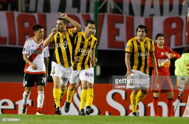 Marcelo Palau of Guarani celebrates with teammates after scoring the first goal of his team during a second leg match between River Plate and Guarani...