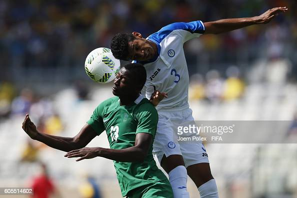 Marcelo Pereira of Honduras and Sadiq Umar of Nigeria compete for the bal during the Men's Olympic Football Bronze Medal match between Honduras and...