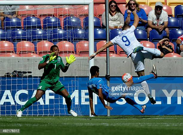 Marcelo Pereira of Honduras deflects the ball away from Jordan Morris of the United States while goalie Luis Lopez of Honduras looks on during the...