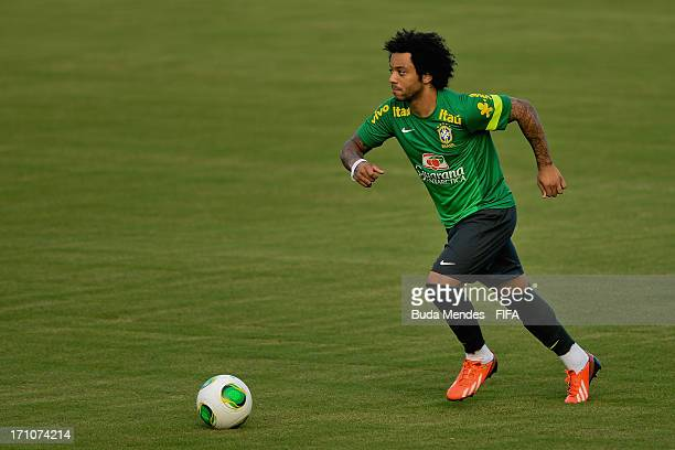 Marcelo practices during a Brazil training session ahead of their FIFA Confederations Cup 2013 match against Italy at Estadio Roberto Santos on June...