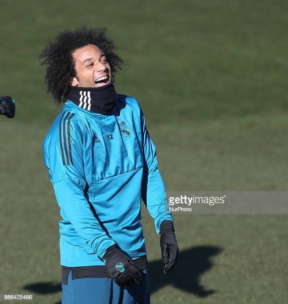 Marcelo reacts during a training session at Valdebebas training ground on December 5 2017 in Madrid Spain