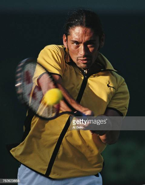 Marcelo Rios of Chile makes a double backhand return to Byron Black during their Men's Singles third round match at the ATP Lipton Tennis...