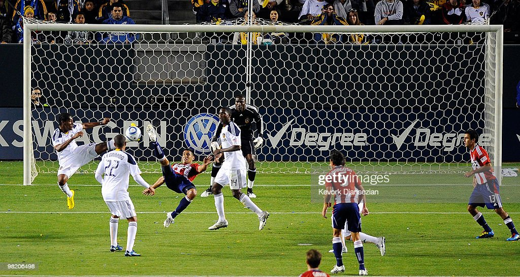 <a gi-track='captionPersonalityLinkClicked' href=/galleries/search?phrase=Marcelo+Saragosa&family=editorial&specificpeople=178311 ng-click='$event.stopPropagation()'>Marcelo Saragosa</a> (C) of Chivas USA attempts to kick a bicycle kick against Los Angeles Galaxy during the first half of the MLS soccer match on April 1, 2010 in Carson, California.