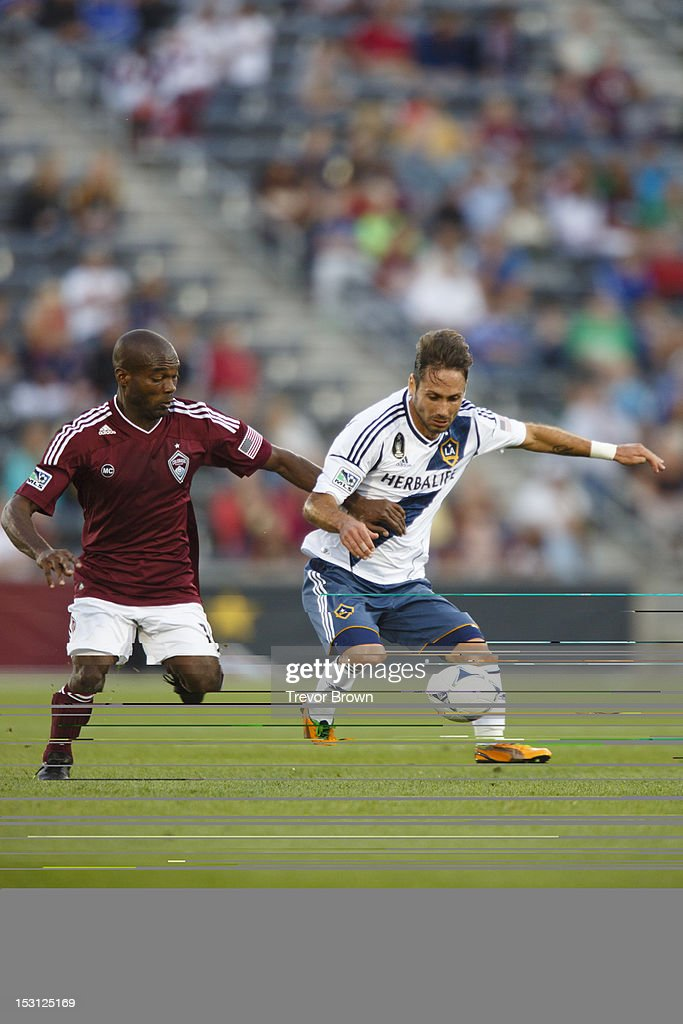 Marcelo Sarvas of Los Angeles Galaxy controls the ball against Omar Cummings of Colorado Rapids during their MLS match at Dick's Sporting Goods Park...
