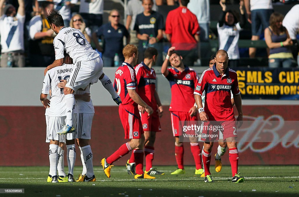 Marcelo Sarvas of the Los Angeles Galaxy celebrates with teammates after a goal by teammate Mike Magee in the second half as Joel Lindpere of the...