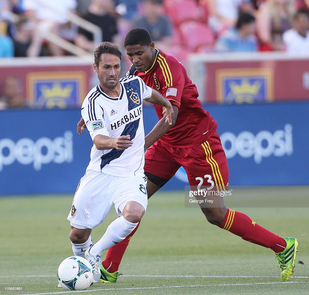 Marcelo Sarvas of the Los Angeles Galaxy moves the ball past Khari Stephenson of Real Salt Lake during the first half of an MLS soccer game June 8...