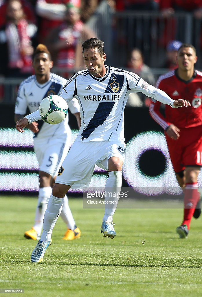 Marcelo Sarvas #8 of the Los Angeles Galaxy plays the ball in an MLS game against the Toronto FC on March 30, 2013 at BMO field in Toronto, Ontario, Canada. The LA Galaxy and the Toronto FC played to a 2-2 tie.
