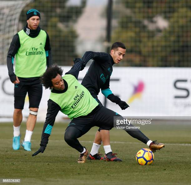 Marcelo Vieira and Lucas Vazquez of Real Madrid in action during a training session at Valdebebas training ground on December 8 2017 in Madrid Spain