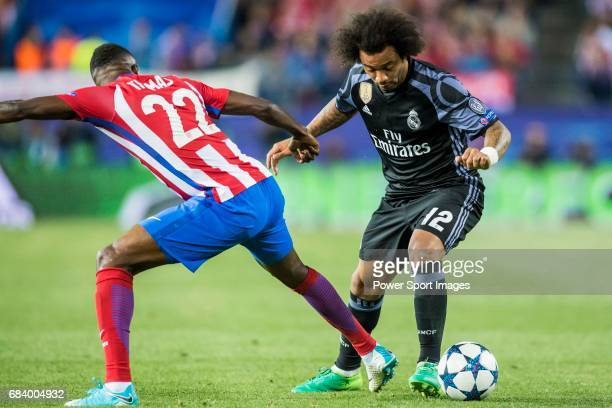 Marcelo Vieira Da Silva of Real Madrid battles for the ball with Thomas Teye Partey of Atletico de Madrid during their 201617 UEFA Champions League...