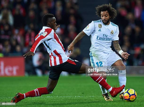 Marcelo Vieira da Silva of Real Madrid CF being followed by Inaki Williams of Athletic Club during the La Liga match between Athletic Club and Real...