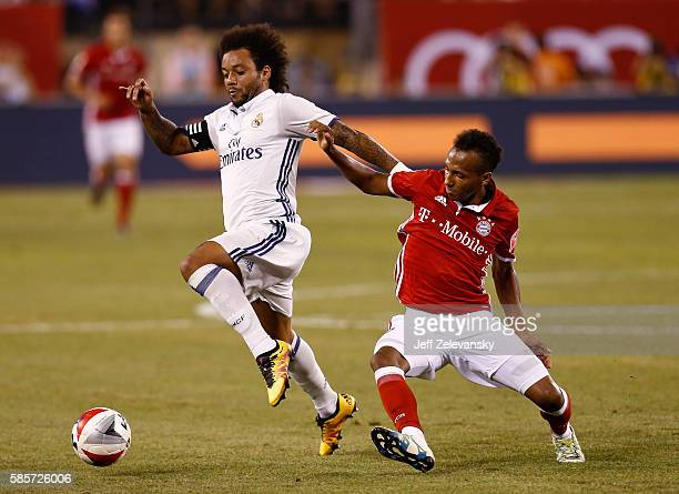 Marcelo Vieira Da Silva of Real Madrid fights for the ball with Julian Green of Bayern Munich during their International Champions Cup match at...