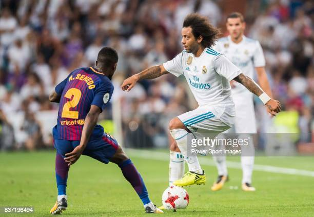 MADRID SPAIN AUGUST 16 Marcelo Vieira Da Silva of Real Madrid fights for the ball with Nelson Cabral Semedo of FC Barcelona during their Supercopa de...