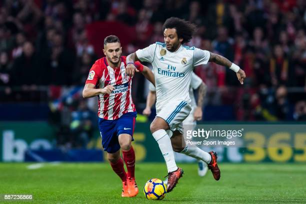 Marcelo Vieira Da Silva of Real Madrid fights for the ball with Saul Niguez Esclapez of Atletico de Madrid during the La Liga 201718 match between...
