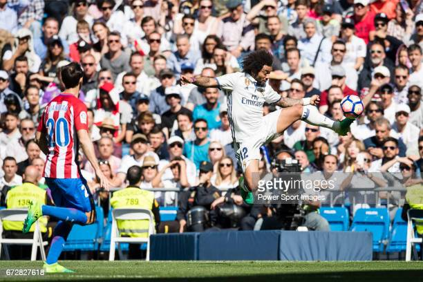 Marcelo Vieira Da Silva of Real Madrid in action during their La Liga match between Real Madrid and Atletico de Madrid at the Santiago Bernabeu...