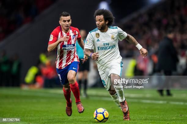 Marcelo Vieira Da Silva of Real Madrid is followed by Angel Correa of Atletico de Madrid during the La Liga 201718 match between Atletico de Madrid...