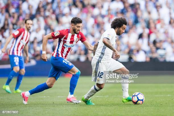 Marcelo Vieira Da Silva of Real Madrid is followed by Yannick Ferreira Carrasco of Atletico de Madrid during their La Liga match between Real Madrid...