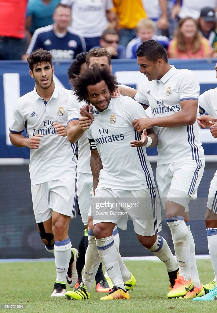 Marcelo Vieira Da Silva of Real Madrid is surrounded by teammates after scoring against Chelsea during the first half at Michigan Stadium on July 30...